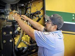 Fernando provides service on a vehicle